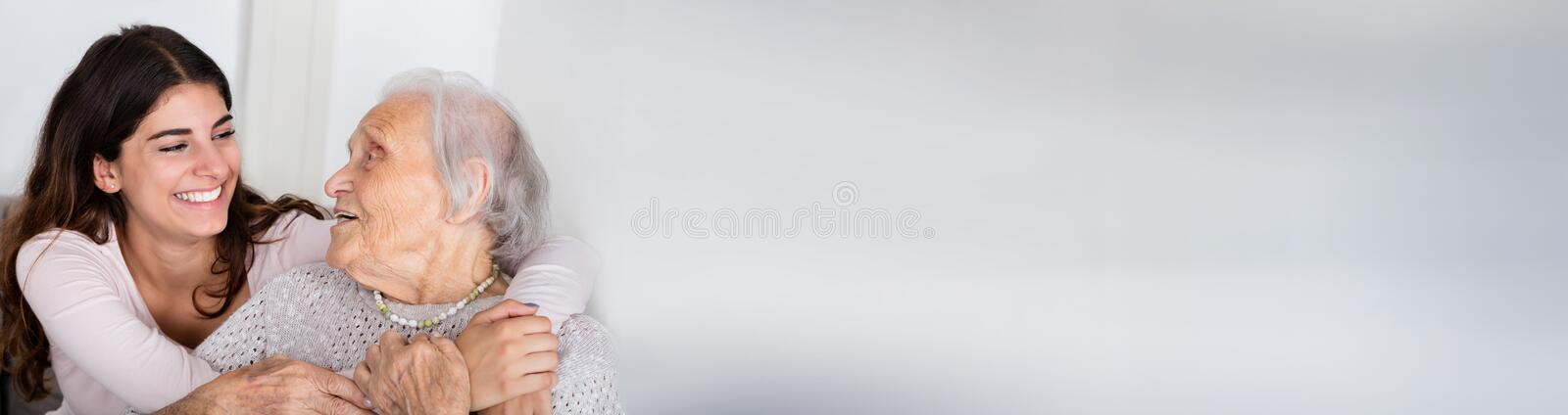 Happy Senior Woman And Granddaughter stock images