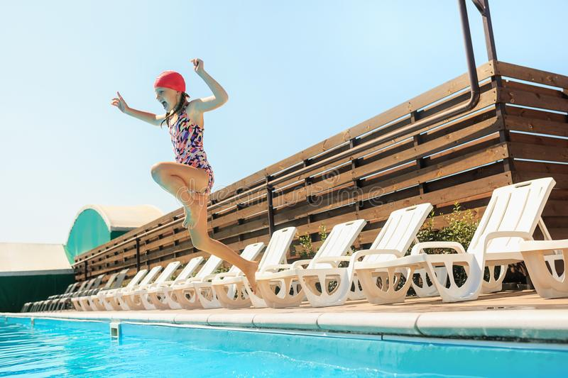 The portrait of happy smiling beautiful teen girl at the pool royalty free stock photography