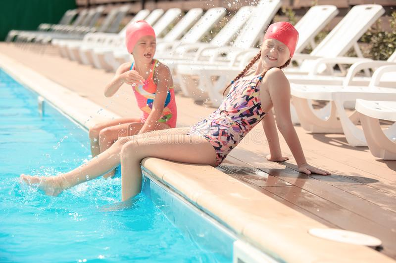 The portrait of happy smiling beautiful teen girls at the pool royalty free stock photo