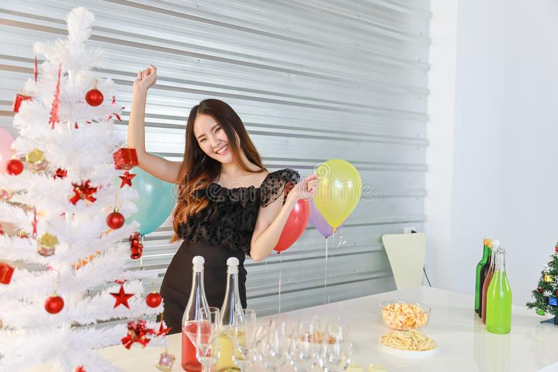 Portrait of happy and smiling beautiful young asian woman in christmas party with food and drink  and color full balloon party royalty free stock photos