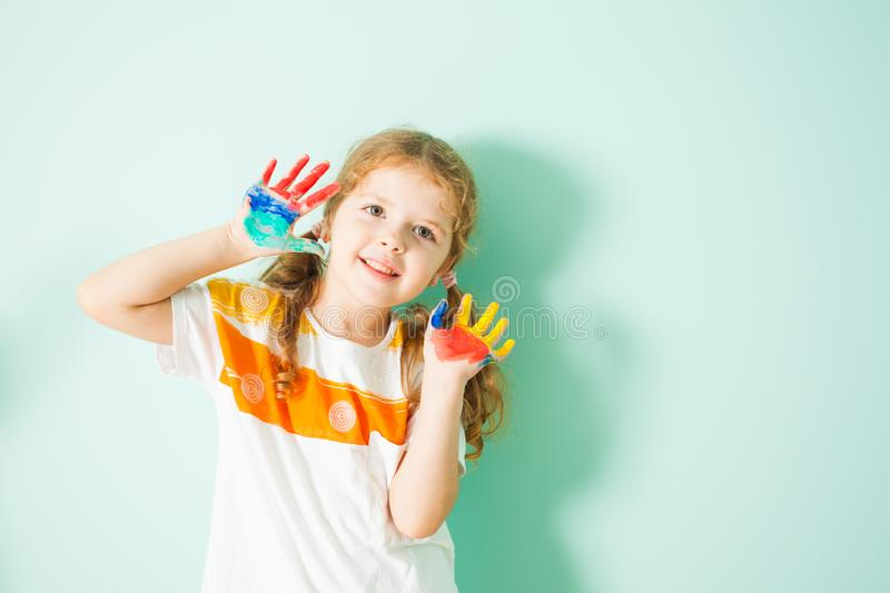 Portrait of happy smiling girl with colored hands stock photo