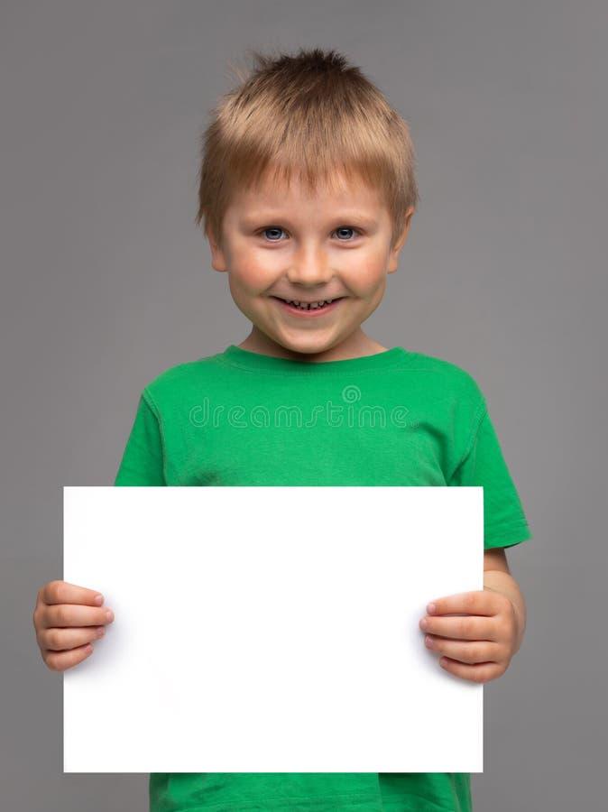 Portrait of happy smiling boy in green t-shirt. Attractive kid in studio. Childhood concept. stock image