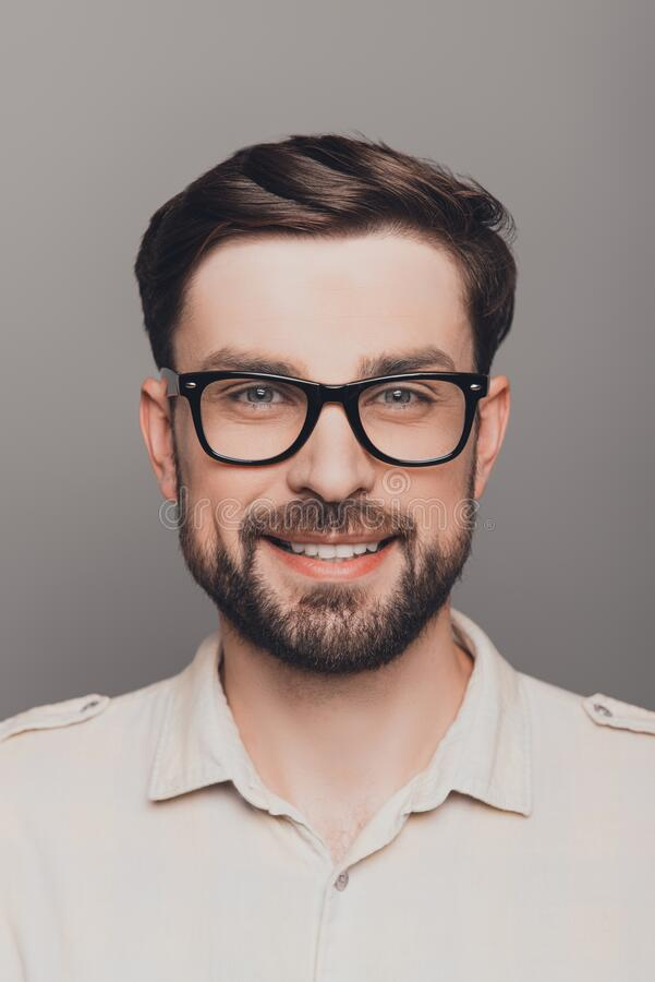 Portrait of happy smiling brainy young guy in spectacles royalty free stock images