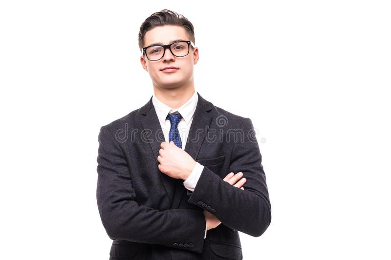 Portrait of happy smiling businessman in crossed arms pose, in black confident suit, against grey background. Caucasian male model royalty free stock photography