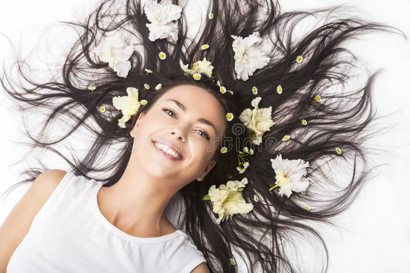 Portrait of Happy Smiling Caucasian Brunette Woman Laying on Floor With Hair Outspread stock images