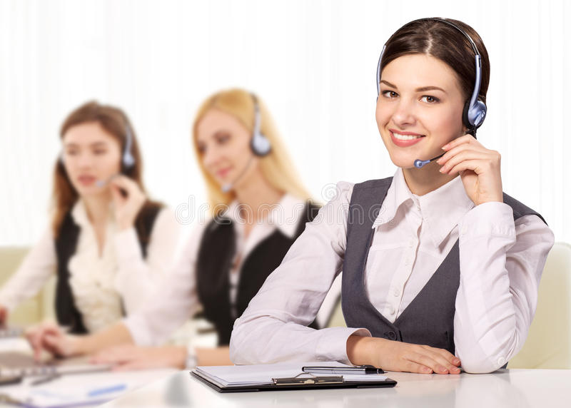 Portrait of happy smiling cheerful support phone operator in headset royalty free stock photo