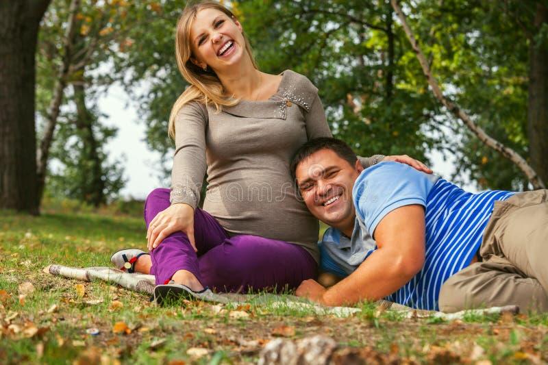Portrait happy smiling couple of future parents stock photo