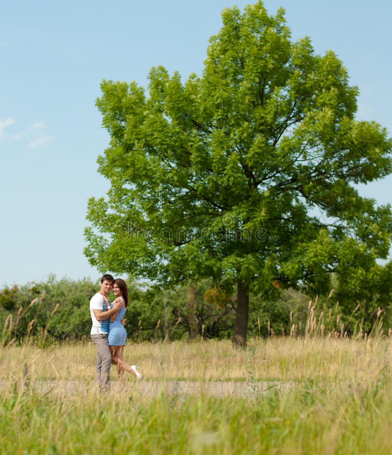 Portrait Of A Happy Smiling Couple Near Oak Tree Royalty Free Stock Images