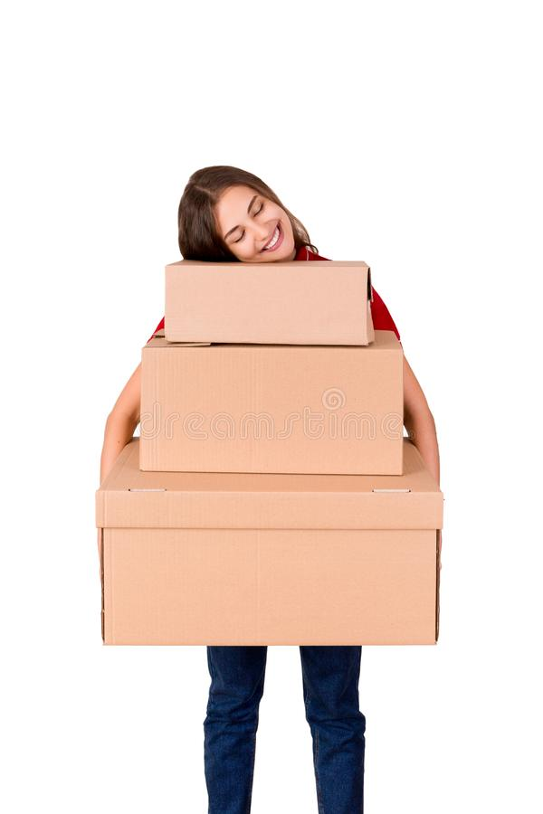 Portrait of a happy smiling delivery woman with heap of big boxes isolated on white background stock image