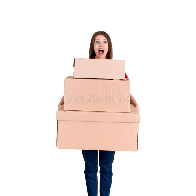 Portrait of a happy smiling delivery woman with heap of big boxes isolated on white background royalty free stock photography