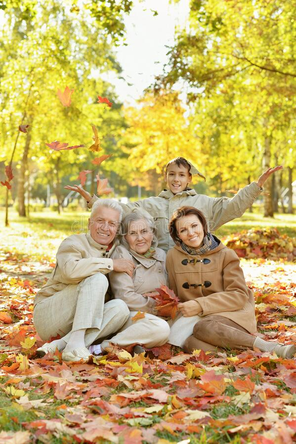 Portrait of happy family relaxing in autumn forest royalty free stock photography