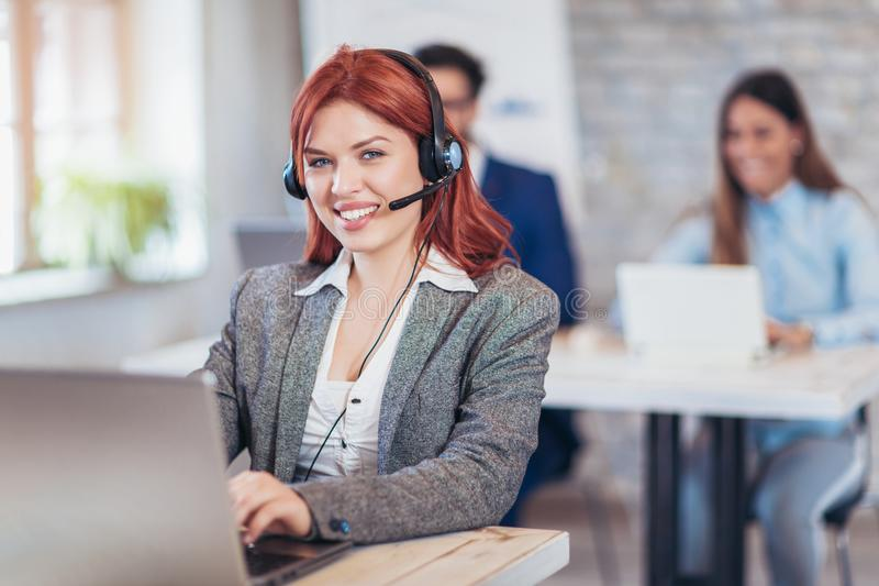 Portrait of happy smiling female customer support phone operator stock photos