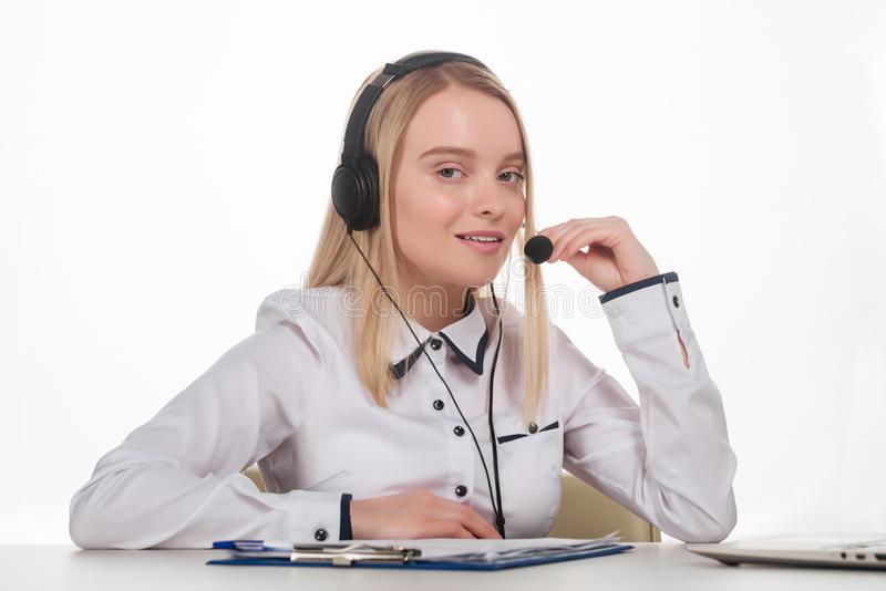 Portrait of happy smiling female customer support phone operator at workplace stock photos