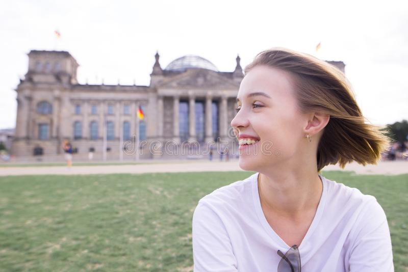 Portrait of a happy smiling girl in Berlin, Germany. Smiling student on the background of European architecture royalty free stock photos