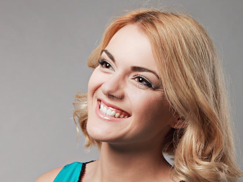Portrait of the happy smiling girl posing in studio. stock images
