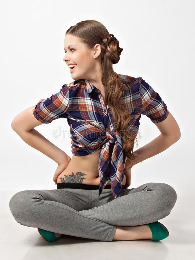 Portrait of the happy smiling girl sitting on floor. royalty free stock photo