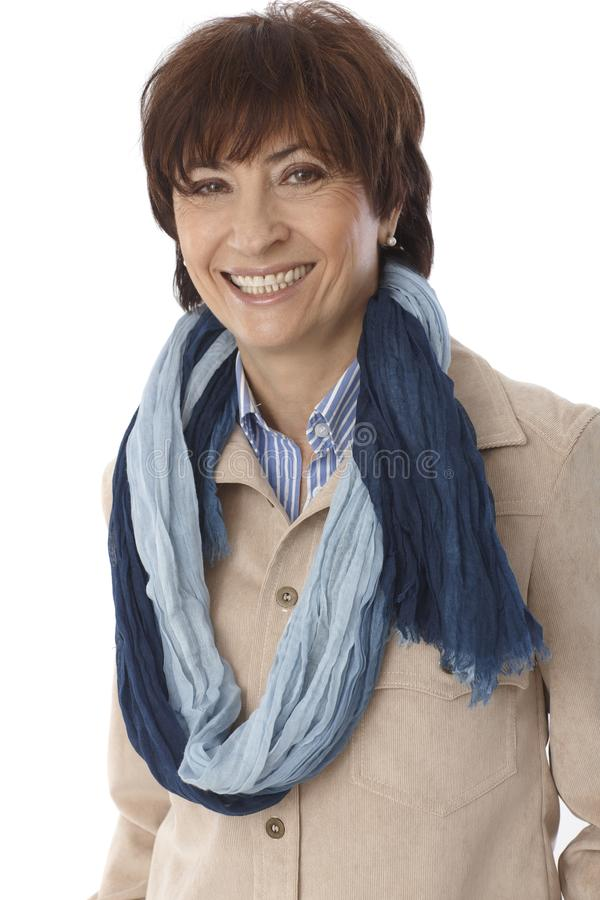 Portrait of happy smiling mature woman. In scarf, looking at camera stock images