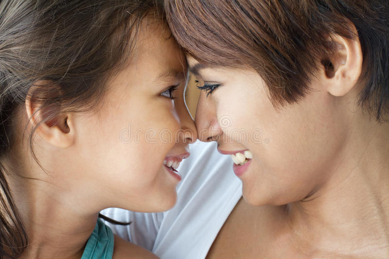 Portrait of happy, smiling, positive mother and daughter royalty free stock photography
