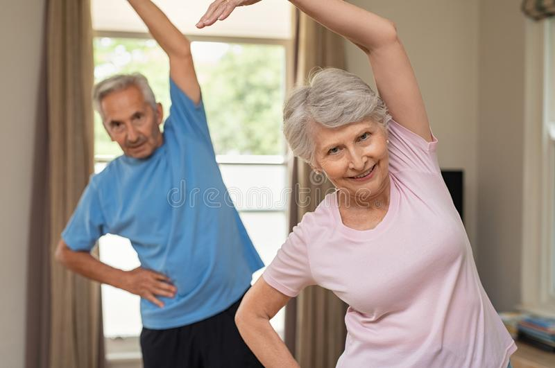 Senior couple doing stretching exercise stock photo