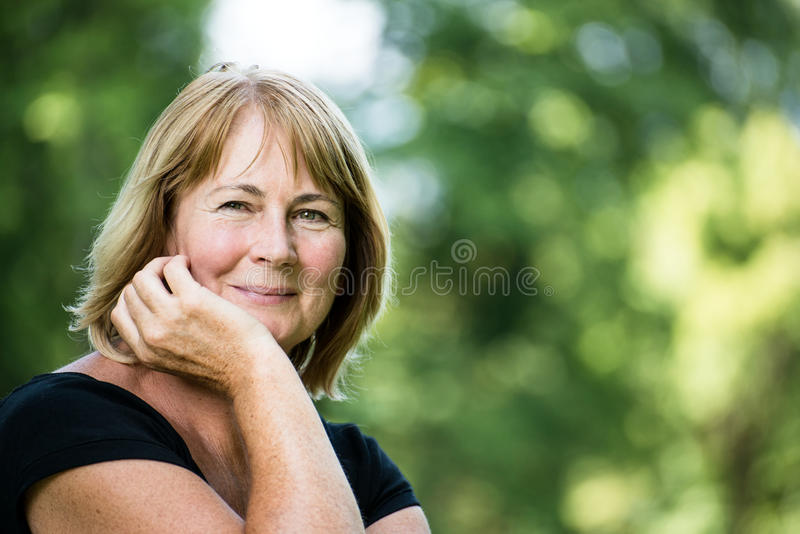 Smiling mature woman outdoor portrait stock photography