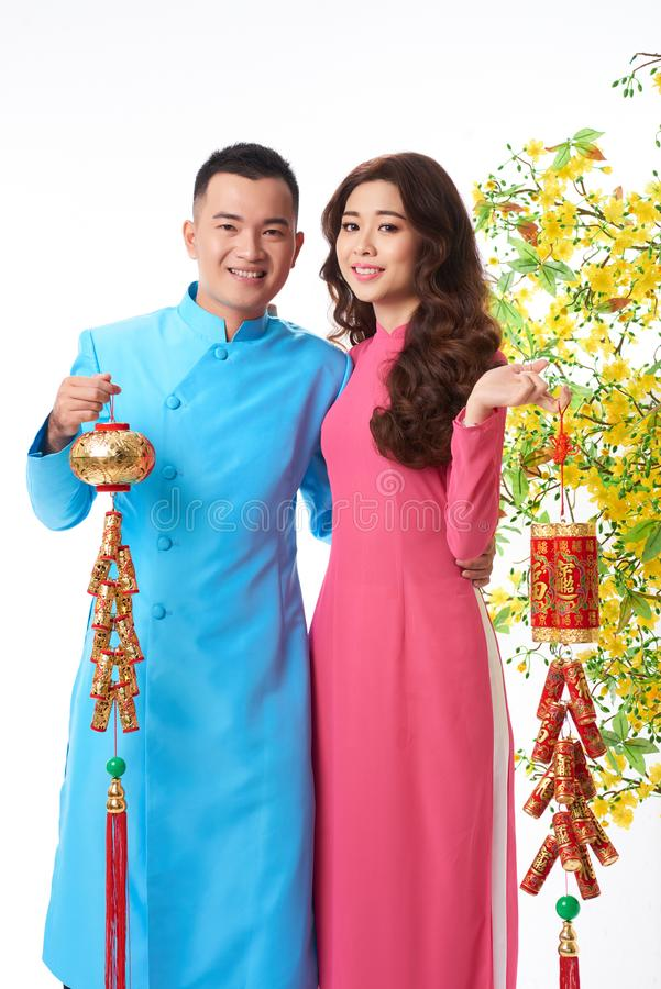 Young couple celebrating Tet royalty free stock image