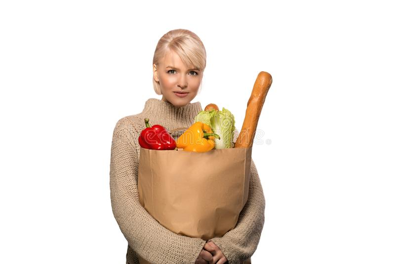 Woman with groceries shopping bag stock photo