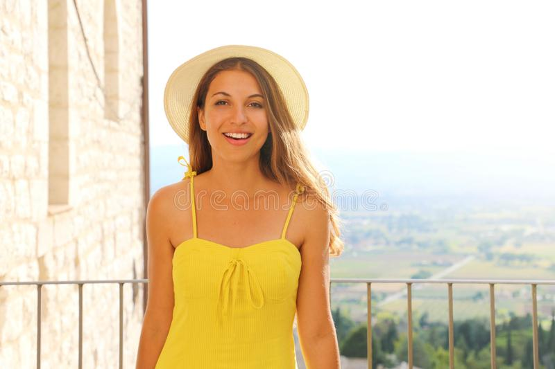 Portrait of happy smiling woman standing on the terrace on sunny summer or spring day outside. Pretty cute smiling woman looking royalty free stock photo