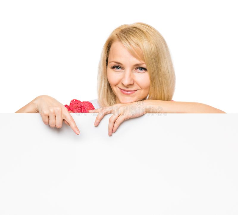 Woman with blank signboard. Portrait of happy smiling young woman, showing empty blank signboard with copyspace. Businesswoman holding big white banner, isolated stock photos