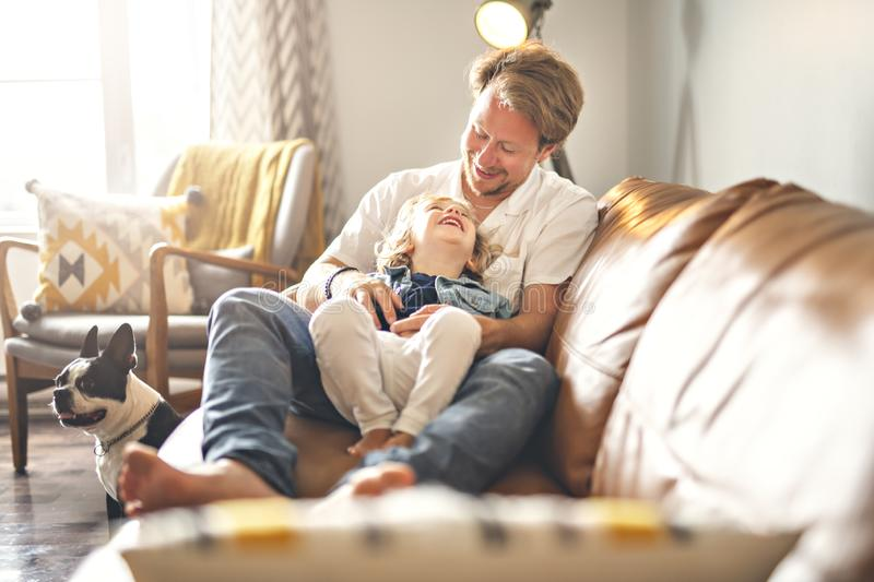 Portrait of happy son with father at home stock image