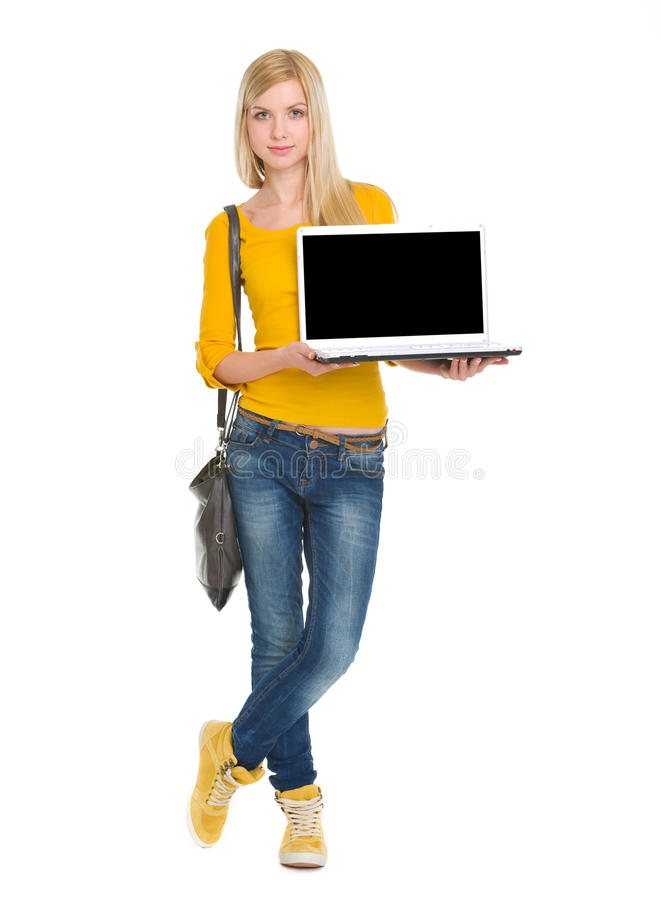 Portrait Of Happy Student Girl Showing Laptop Stock Photography