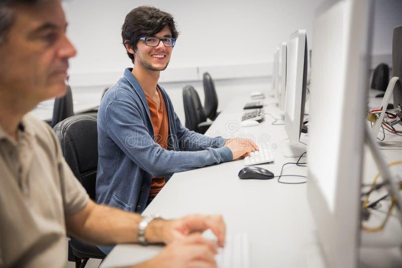 Portrait of happy student using computer stock photo