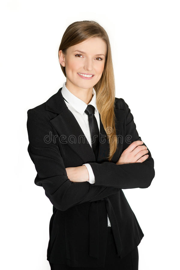 Portrait of a happy and successful middle aged female business executive with crossed arms against white background of woman or royalty free stock image