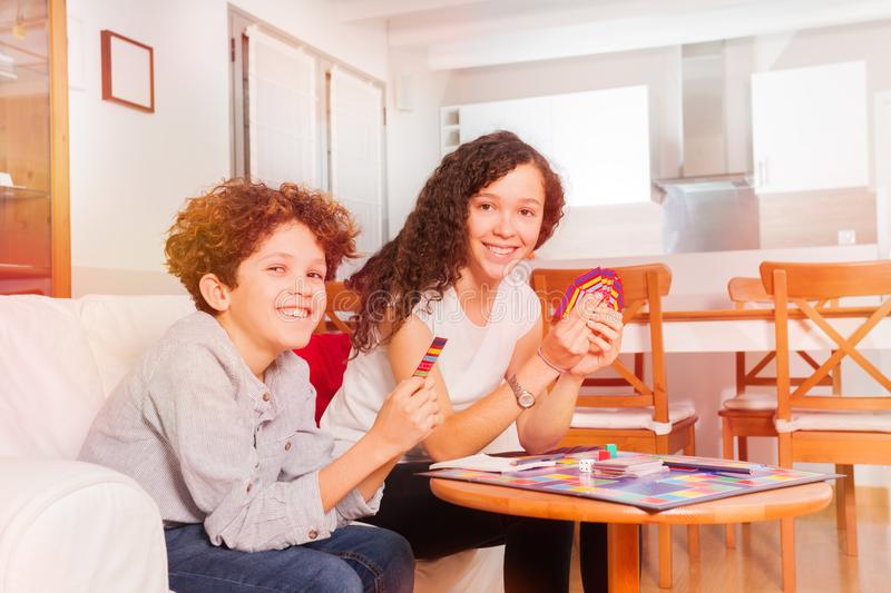 Happy teens playing card games in the living room royalty free stock image