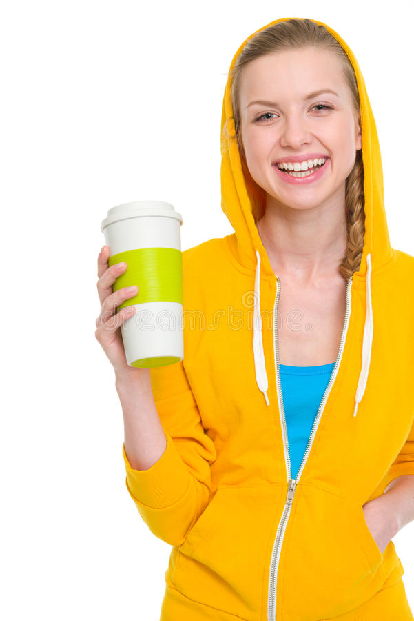 Portrait of happy teenager girl holding coffee cup. Isolated on white stock photos