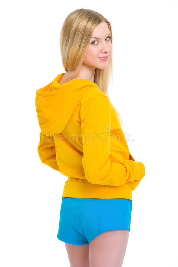 Portrait of happy teenager girl looking back. Isolated on white royalty free stock photography