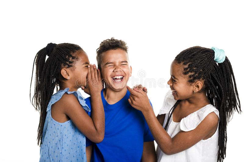 Portrait of happy three black childrens, white background royalty free stock images