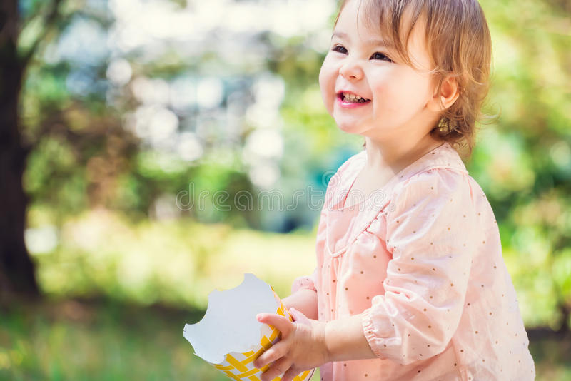 Portrait of a happy toddler girl playing with a big smile stock photos