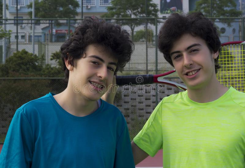 Portrait of happy twins on the court stock image