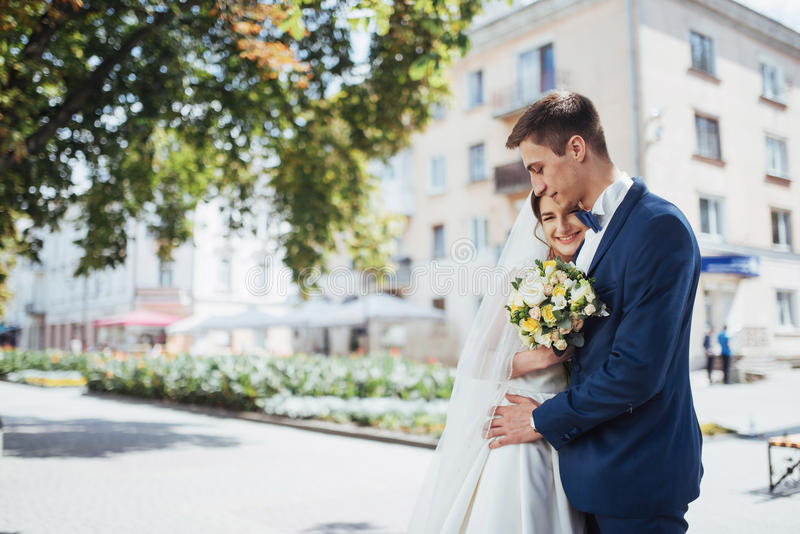 Portrait of happy wedding couple outdoors. Fantastic summer day.  royalty free stock photos