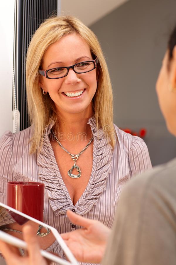 Portrait of happy woman. Portrait of happy blonde women talking to someone, smiling royalty free stock photo