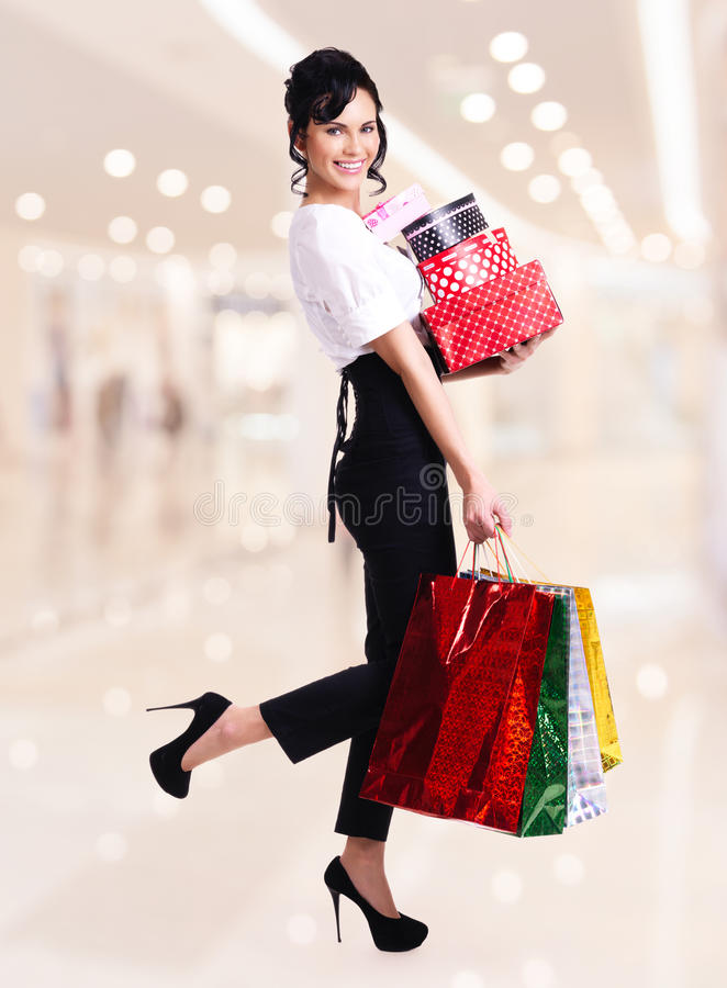 Download Portrait Of Happy Woman With Color Shopping Bags. Stock Photo - Image: 38319546