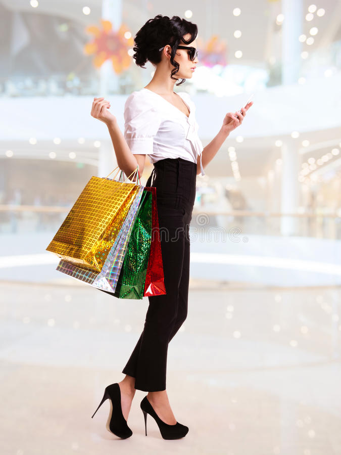 Download Portrait Of Happy Woman With Color Shopping Bags. Stock Image - Image: 38319639