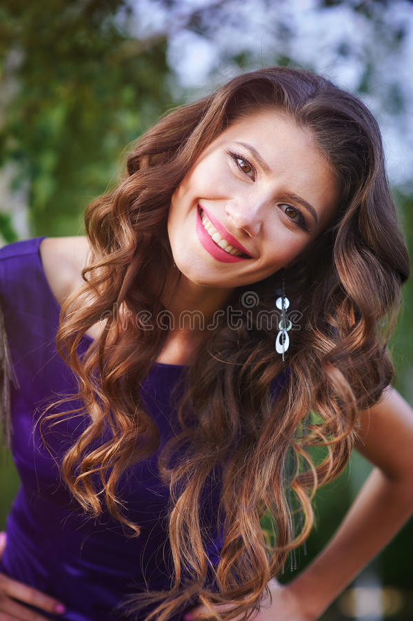 Portrait of a happy woman with curled hair outdoors.  stock image