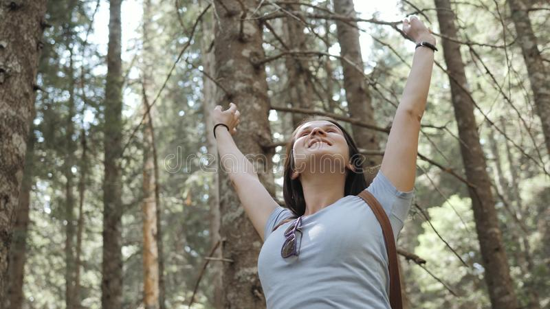 Portrait of a Happy Woman In Forest, Girl Enjoy Wood, Tourist With Backpack In National Park, Travel Lifestyle royalty free stock image