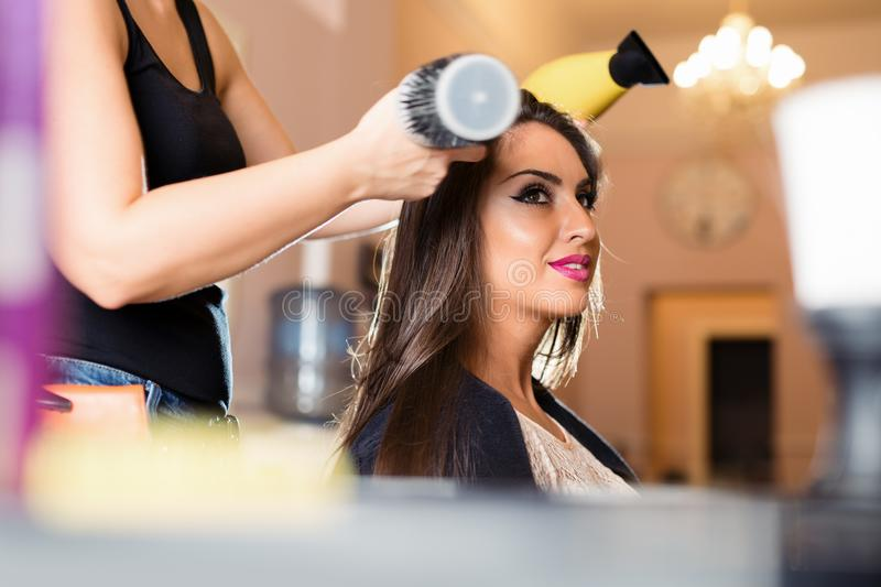 Portrait of a happy woman at the hair salon stock photos