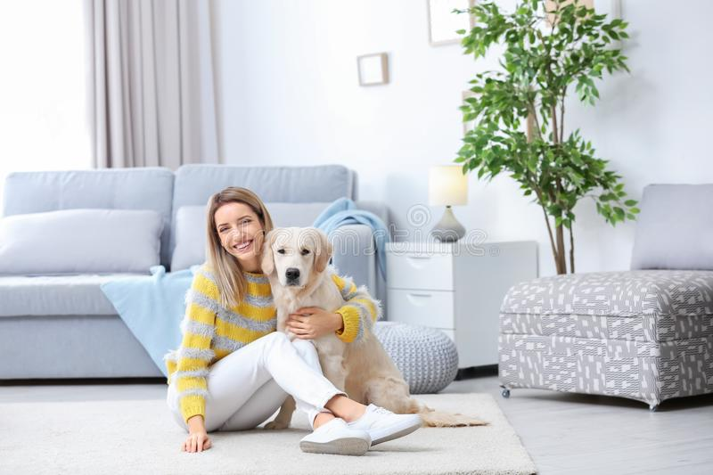Portrait of happy woman with her dog royalty free stock photos