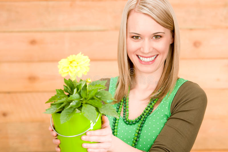 Portrait happy woman hold yellow flower spring royalty free stock photos