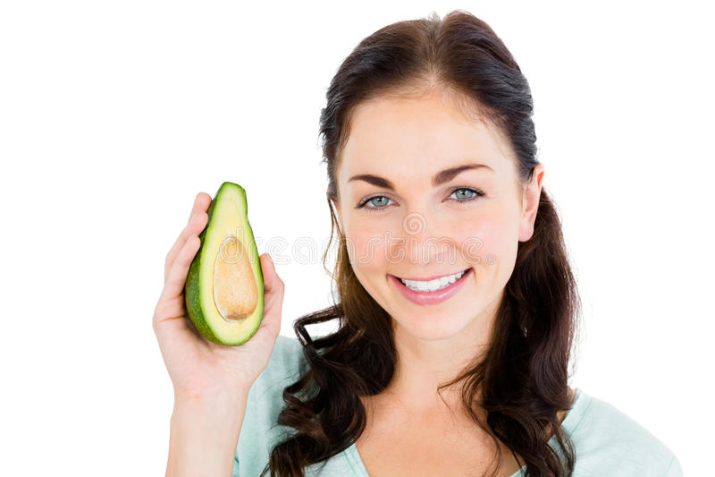 Portrait of happy woman holding avocado royalty free stock photo