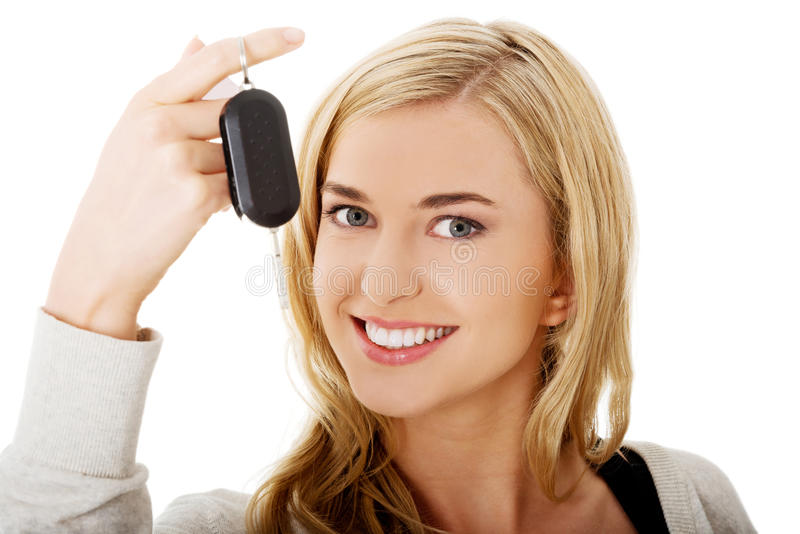 Portrait of happy woman holding a car key.  royalty free stock photo
