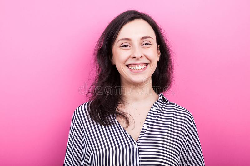 Portrait of happy woman laughing to the camera stock images